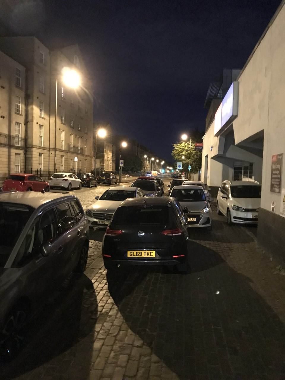 parked cars in the dark